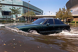 30 August 2005. New Orleans, Louisiana. <br /> Hurricane Katrina aftermath.  <br /> A driver escapes from the Hyatt Hotel as the flood waters continue to rise.<br /> Photo Credit: Charlie Varley/varleypix.com