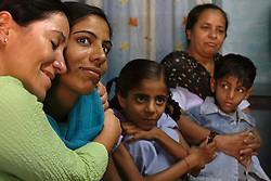 American Jessica Ordenes, 40, and her surrogate Najima Vohra, 30, spend time at Najima's home in Anand, India on April 12, 2007.  Najima, a first time surrogate, wants to pay for her two children's education with the money she will make from this pregnancy. Dr. Nayna Patel, the hospital director, currently has more than 25 women who have been implanted with embryos at her clinic. A few have already gone through the process once and are eager for a second go-round. While Patel claims many of the women do this for altruistic reasons, she acknowledges that money was the primary reason these women had queued up to be surrogates; without it, the list would be short, if not nonexistent. Payment usually ranges from about $2,800 to $5,600, a fortune in a country where annual per capita income hovers around $500.