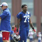 Damontre Moore (centre, 79), during a training routine during the 2013 New York Giants Training Camp at the Quest Diagnostics Training Centre, East Rutherford, New Jersey, USA. 29th July 2013. Photo Tim Clayton.