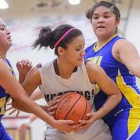 021414       Cable Hoover<br /> <br /> Ramah Mustang Taea Hill (24) fights off Zuni Thunderbirds  Rani Yamutewa (10) and Iyana Sepo-Owaleon (33)Friday at Ramah High School.