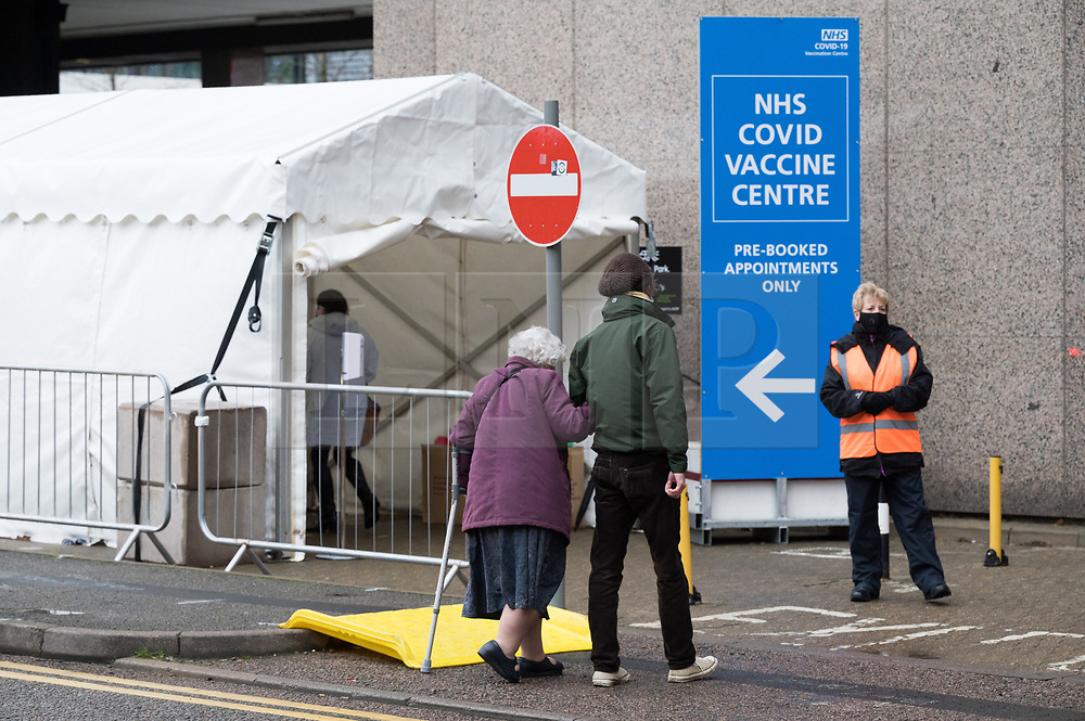 © Licensed to London News Pictures. 20/01/2021. London, UK. An elderly woman walks into the Olympic Office Centre, near Wembley Stadium to receive a Covid-19 vaccination jab. The hub is is one of 10 new centres inviting over 70 year olds to receive a vaccination. Photo credit: Ray Tang/LNP