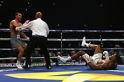Wladimir Klitschko (left) puts Anthony Joshua down during their IBF, WBA and IBO Heavyweight World Title bout at Wembley Stadium, London.