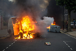 © Licensed to London News Pictures . 08/08/2011 . London , UK . Van and wheelie bin set alight on the Pembury Estate in Hackney during a 3rd night of rioting and looting in London , which followed a protest against the police shooting of Mark Duggan in Tottenham . Photo credit : Joel Goodman/LNP