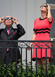 United States Secretary of Commerce Wilbur Ross and Ivanka Trump look at the partial eclipse of the sun from the Blue Room Balcony of the White House in Washington, DC on Monday, August 21, 2017.<br /> (Photo by Ron Sachs/CNP/Sipa USA)