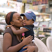 Haitian Mother Kissing Daughter in a Beauty Salon in Florida