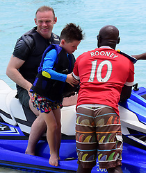 EXCLUSIVE: Wayne Rooney and eldest son Kai pictured on a jetski while on holiday in Barbados. 26 May 2017 Pictured: Wayne Roney and son Kai. Photo credit: Shanice King/246paps / MEGA TheMegaAgency.com +1 888 505 6342