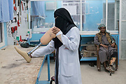 """Mcc0081437 . Daily Telegraph<br /> <br /> DT Foreign<br /> <br /> Fayda Ali Ali, a nurse trained in prosthetics adjust a limb as an amputee looks on in the orthopaedic ward in a hospital in the government held town of Marib , over 100 miles from the county's capital Sanaa which is in the hands of the Houthi rebels . <br /> The country has been in the midst of a civil war since 2015 when the President Abdrabbuh Mansur Hadi was forced to flee . A Saudi led coalition with 9 other Arab states  named """"Operation Decisive Storm """"  has since sought to restore Hadi with little effect .<br /> <br /> Yemen 20 February"""