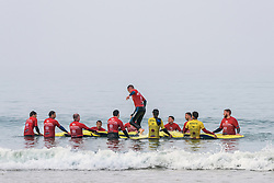 A surf school teaching at Fistral in Newquay, Cornwall.