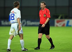Sasa Bakaric and referee Peter Sart at 30th Round of Slovenian First League football match between NK Domzale and NK MIK CM Celje in Sports park Domzale, on April 25, 2009, in Domzale, Slovenia. Celje won 3:0. (Photo by Vid Ponikvar / Sportida)