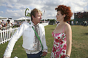 Nicky Haslam and Cleo Rocos, Cartier International Polo. Guards Polo Club. Windsor Great Park. 30 July 2006. ONE TIME USE ONLY - DO NOT ARCHIVE  © Copyright Photograph by Dafydd Jones 66 Stockwell Park Rd. London SW9 0DA Tel 020 7733 0108 www.dafjones.com