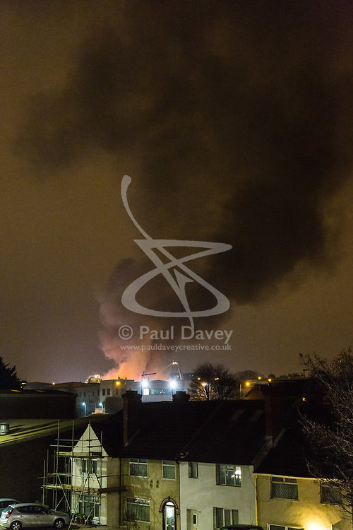 London, January 09 2018. A noxious cloud of smoke towers over London as over 90 Firefighters and 15 fire engines tackle a blaze at a paint factory in Waterloo Road, Staples Corner, west London. © Paul Davey