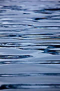 Water ripples in Magdalenefjorden, and 8km long, 5km wide fjord on the west coast of Spitsbergen, in the Arctic archipelego of Svalbard. Large cruise ships regularly enter the fjord. However, heavy fuel oil, which is used in many ships, is banned in Magdalenefjorden. However, Magdalenefjorden is regarded as having being sacrificed to tourism to protect other areas of Svalbard.