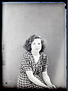 vintage studio portrait of a young adult woman looking at the camera, circa 1930s