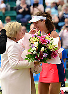Johanna Konta (GBR) is presented with a gift after winning her 300th match during her match against Tara Moore (GBR). The Aegon Open Nottingham 2017, international tennis tournament at the Nottingham tennis centre in Nottingham, Notts , day 2 on Tuesday 13th June 2017.<br /> pic by Bradley Collyer, Andrew Orchard sports photography.