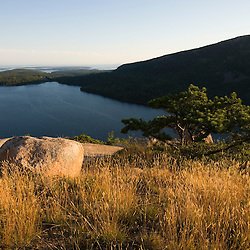 A grassy area on the summit of South Bubble Mountain in Maine's Acadia National Park. Jordan Pond is below.