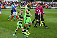 Forest Green Rovers Liam Noble(8) with the mascot during the EFL Sky Bet League 2 match between Forest Green Rovers and Exeter City at the New Lawn, Forest Green, United Kingdom on 9 September 2017. Photo by Shane Healey.