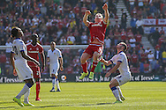 Middlesbrough midfielder Grant Leadbitter gets up high for the ball during the Sky Bet Championship match between Middlesbrough and Leeds United at the Riverside Stadium, Middlesbrough, England on 27 September 2015. Photo by Simon Davies.