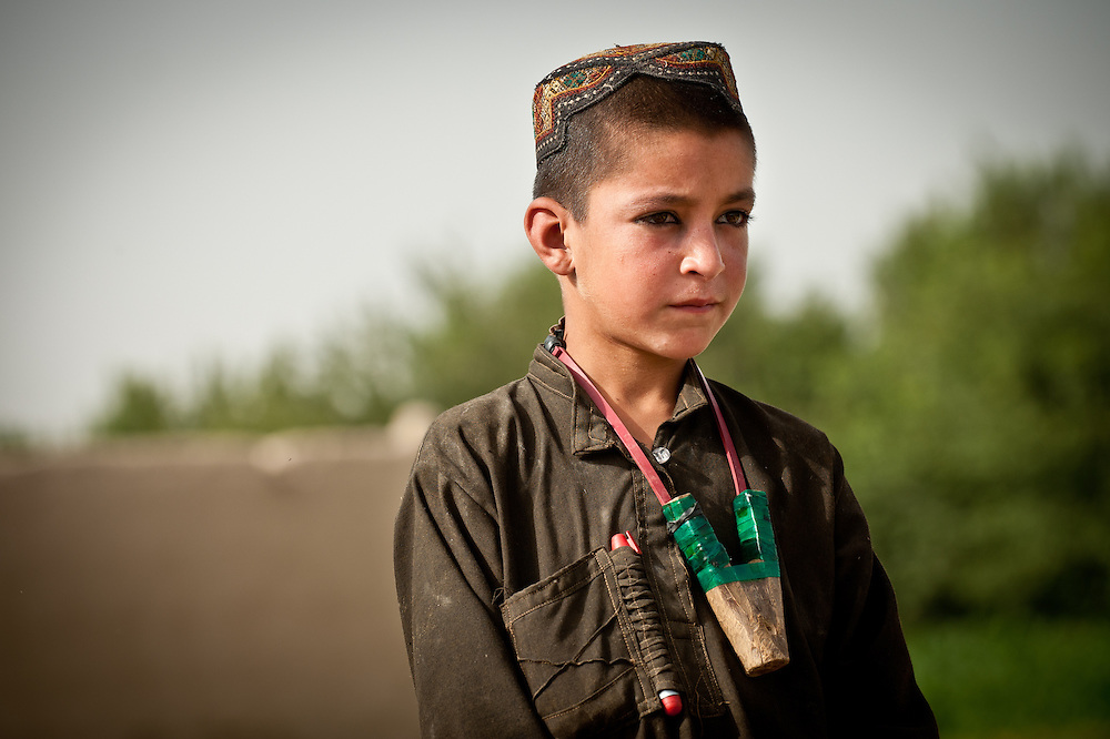 An Afghan village boy with a homemade slingshot.