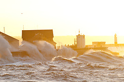 © Licensed to London News Pictures. 01/02/2014. Porthcawl, Bridgend, Wales, UK. Huge waves and strong winds batter the South Wales seaside resort of Porthcawl. The 10.90 metre predicted high tide mark for 07.15 hrs this morning was considerably increased by the effect of the storm's accompanying 'tidal surge'. Photo credit : Graham M. Lawrence/LNP