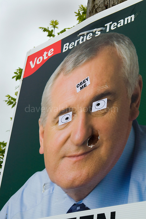 """Defaced Fianna Fail election poster in  Ennistymon altered with stickers saying: """"Obey Me"""".."""