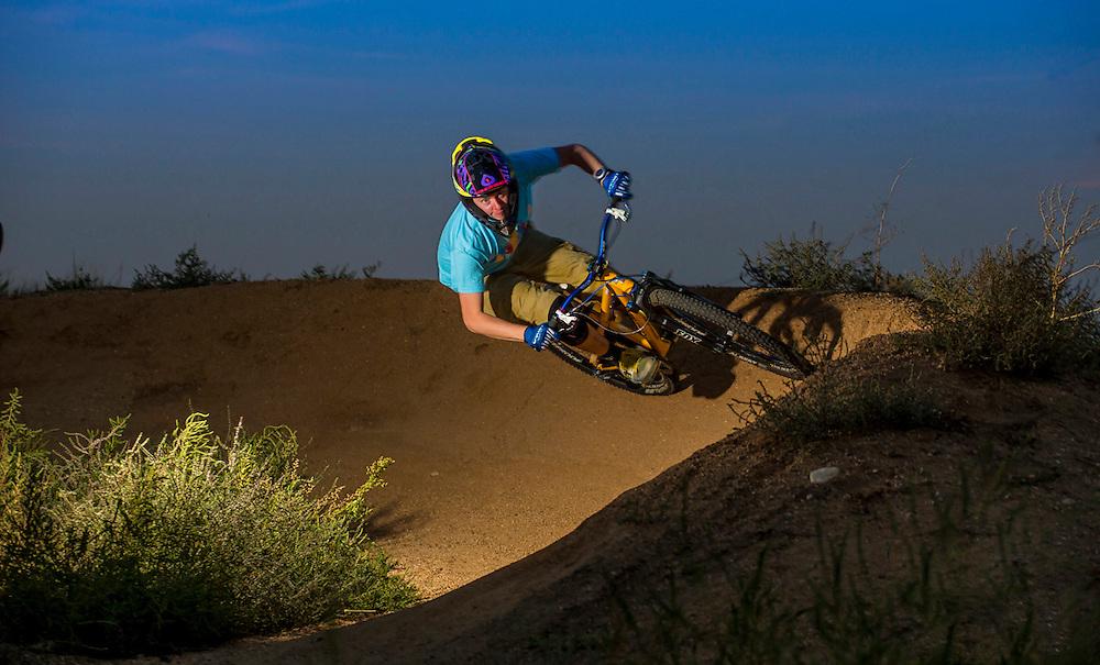 Mountain Biker riding through berm. Golden, Colorado