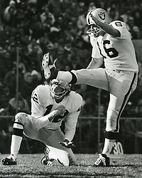 George Blanda kicks field goal out of the hold of QB Ken Stabler. (copyright 1972 Ron Riesterer)