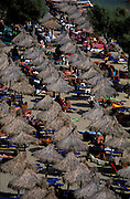 GREECE: Grass umbrellas of .Paradise Beach, Mykonos