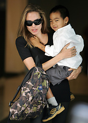 Please hide child face prior to the publication Actress Angelina Jolie picks up her son Maddox at The Lycee Francais de New York in Upper East Side in New York City, NY, USA on September 7, 2007. Photo by Cau-Guerin/ABACAPRESS.COM  | 131036_04 New York City Unitd