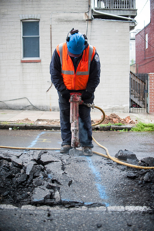 Photo by Matt Roth<br /> <br /> Baltimore City Department of Public Works foreman George Gaines mans a 90 lbs jackhammer at a residential break in water service at 3101 Dillon St. in Baltimore, Maryland on Tuesday, May 07, 2013.