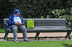 © Licensed to London News Pictures. 31/08/2018<br /> GREENWICH, UK.<br /> An elderly man takes a nap.<br /> Bright weather with some cloud in London today as people enjoy the last day of August at Greenwich Park, Greenwich.<br /> Photo credit: Grant Falvey/LNP