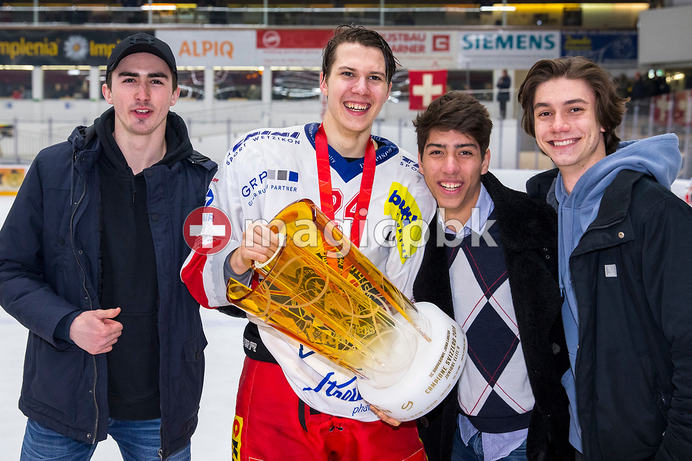 Rapperswil-Jona Lakers forward Lars Mathis poses with the Swiss Champion trophy and his buddies after winning ice hockey game 4 of the Elite B Playoff Final between EHC Chur Capricorns and Rapperswil-Jona Lakers in Chur, Switzerland, Friday, March 16, 2018. (Photo by Patrick B. Kraemer / MAGICPBK)