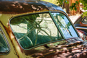 Cracked windshield on rusting car in Benton Hot Springs, Mono County, California, USA. Benton Hot Springs (elevation 5630 feet) saw its heyday from 1862 to 1889 as a supply center for nearby mines. At the end of the 1800s, the town declined and the name Benton was transferred to nearby Benton Station.
