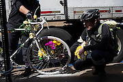 Families and friends of New Yorkers killed while bicycling on New York City streets gather at a Ghost Bike memorial for Terence Connor at the corner of Metropolitan Ave. & Stewart Ave. in Brooklyn, NY, on Sunday, April 21, 2013 as they participate in the 8th Annual Ghost Bike Memorial Ride. The ride visited the 20 white-painted Ghost Bikes installed at the scene of bicyclist fatalities in five boroughs before converging at the intersection of Queens Boulevard and Jackson Avenue to dedicate a memorial to all of the cyclists who were killed in traffic crashes in 2012 whose deaths did not make the news...According to the New York City Department of Transportation, 136 pedestrians and 18 bicyclists were killed in 2012. In 2011, 134 pedestrians and 22 bicyclists were killed on New York City streets. To date, at least two bicyclists have been killed in 2013...Photograph by Andrew Hinderaker for the Ghost Bike Project.