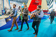 A jazz trio wanders through the show providing entertainment. The CWM FX London Boat Show, taking place 09-18 January 2015 at the ExCel Centre, Docklands, London. 09 Jan 2015.