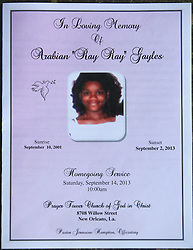 14 September 2013. Prayer Tower Church of God in Christ. New Orleans, Louisiana. <br /> The order of service and tribute for 11 yr old Arabian 'Ray Ray' Gayles, fatally shot September 2nd. Arabian was cradling a 1 yr old cousin whilst sat on the couch at home when gunmen pulled up outside and sprayed the house with bullets. Arabian was hit in the head and died shortly afterwards. NOPD is questioning 2 men in connection with the murder.<br /> Photo; Charlie Varley