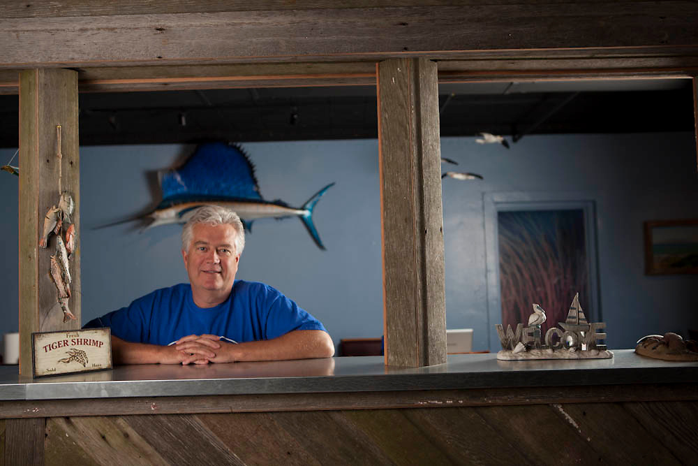 """22 May 2012- Greg Linberg is photographed at his restaurant """"Shuck's Fish House"""" for The Encounter Magazine."""