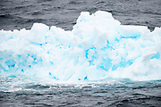 An iceberg that looks blue in the sea en route to Antarctica from the Falkland Islands on Wednesday 14 February 2018.