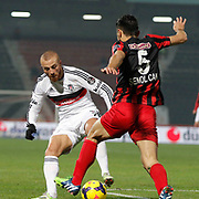 Besiktas's Gokhan Tore (L) during their Turkish superleague soccer match Gaziantepspor between Besiktas at the Kamil Ocak stadium in Gaziantep Turkey on Sunday 14 December 2014. Photo by Kurtulus YILMAZ/TURKPIX