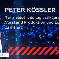 Peter Kossler production and logistics director of Audi AG pose with the first E-Engine at the production start of electric engines at the Audi car factory in Gyor (about 120 km West of Budapest), Hungary on July 24, 2018. ATTILA VOLGYI