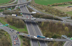 """A jackknifed lorry is hanging off a motorway bridge causing miles of tailbacks.<br /> The main carriageway is currently closed in both directions at junction 2 for the Darenth Interchange.<br /> <br /> The serious crash involving a lorry has closed the M25 near the Darenth Interchange in both directions.<br /> It is due to the HGV perched precariously above the A2, which is also shut in both directions.<br /> Part of the lorry's trailer is breaching a safety barrier and has caused significant damage.<br /> Traffic officers are currently at the scene and police were called at 1.20pm. No serious injuries have been reported.<br /> <br /> There are at least six miles of tailbacks approaching the Dartford Crossing going back past junction 3 for the Swanley Interchange.<br /> All traffic is being diverted via the Darenth Interchange roundabout.<br /> <br /> Emergency services have been called to the scene of the crash. Photo: Highways England<br /> Kent Police spokesman James Walker, said: """"Road closures are in place following a collision between a lorry and a roadside barrier on the A282.<br /> """"The incident was reported to Kent Police at 1.20pm and resulted in part of the lorry's trailer breaching a safety barrier.<br /> """"No serious injuries have been reported, however the A2 is closed in both directions, at the junction for the Darenth Interchange, to ensure public safety. The anticlockwise M25 is also closed at junction 2.<br /> <br /> """"Motorists are advised to expect delays and, where possible, consider using an alternative route.""""<br /> There are delays of up to an hour reported in the area and on the approach to the incident on both directions of the M25 and A2, with additional delays on the diversion routes.<br /> Highways England has advised drivers to allow extra time if travelling in the area or to consider alternative routes."""