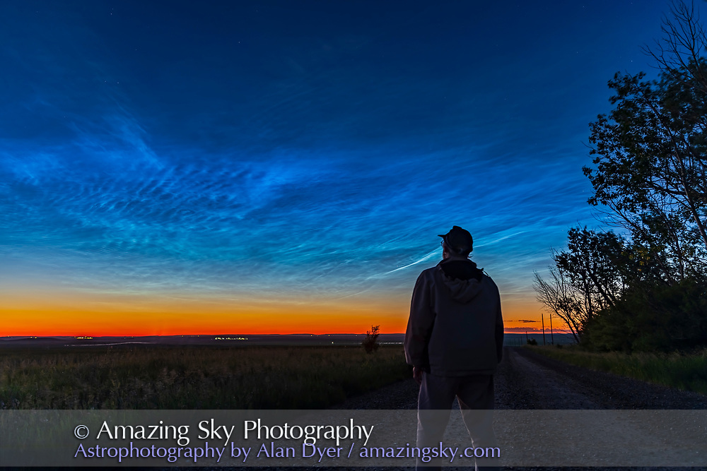A selfie with a grand display of noctilucent clouds on June 27, 2021, shot from home.<br /> <br /> This is a single shot with the 24-105mm f/4 RF lens and Canon Ra camera.