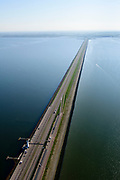 Nederland, Noord-Holland, Den Oever, 07-05-2018; Afsluitdijk met Vlietermonument. Het Monument is verrezen op de plaats - de Vlieter - waar het laatste gat in de Afsluitdijk in 1932 gesloten werd. Noord-Holland aan de verre horizon. IJsselmeer links in beeld.<br /> Enclosure Dam with Monument. Waddenzee (right).<br /> <br /> luchtfoto (toeslag op standard tarieven);<br /> aerial photo (additional fee required);<br /> copyright foto/photo Siebe Swart