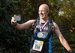 © Licensed to London News Pictures. 11/04/2020. Stoneleigh, UK. Kevin Webber talks on a Facebook live broadcast after crossing the finishing line on the equivalent last Stage of the Marathon des Sables ultramarathon in his Surrey garden during lockdown. Kevin has run the entire 230Km (143 miles) 6 stage race in his small back and front gardens, completing 2734 laps, over 6 days - finishing today. Kevin, who was diagnosed with terminal prostate cancer just over 5 years ago was due to take part in his 5th consecutive running of what is described as the 'toughest foot race on Earth' through the Sahara Desert in Southern Morocco this month, but the 2020 six day race has been postponed until September.  Kevin is raising funds for the National Emergencies Trust Coronavirus Appeal who will distribute the funds to where they are needed most in the UK and he will jointly split what he raises with Prostate Cancer UK. Photo credit: Peter Macdiarmid/LNP