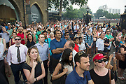 London, UK. Tuesday 23rd July 2013. Public and tourists watch the 62 gun salute at the Tower of London, to mark the birth of the Duke and Duchess of Cambridge's son. Filming the event on their smartphones and cameras.