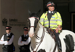 © Licensed to London News Pictures. 15/10/2011, London, UK.  Police officers stand quard outside the London Stock Exchange in the City of London to prevent protesters demonstrating against corporate greed from occupying Paternoster Square which houses the Exchange, Saturday, Oct. 15, 2011. Photo credit : Sang Tan/LNP