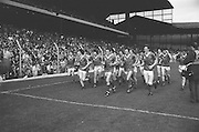 The winning Kerry team run around the pitch celebrating after the All Ireland Senior Gaelic Football Championship Final Kerry v Dublin at Croke Park on the 22nd September 1985. Kerry 2-12 Dublin 2-08.
