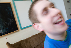 Teenage boy with Autism having fun,