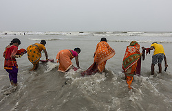 KOLKATA, Aug. 9, 2016 (Xinhua) -- Indian Hindu devotees clean clothes before offering prayers to Lord Shiva, Hindu god of destruction, during Shravan festivities at the confluence of the River Ganges and the Bay of Bengal, some 150 km south of Calcutta, capital of eastern Indian state West Bengal, Aug. 8, 2016. (Xinhua/Tumpa Mondal) .****Authorized by ytfs* (Credit Image: © Tumpa Mondal/Xinhua via ZUMA Wire)