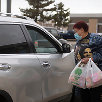 Mona Fraiser receives food donations at St. Paul Missionary Baptist Church in Gallup Monday at their food drive benefiting the Community Pantry Monday in Gallup. Fraiser organized the food drive in honor of Dr. Martin Luther King Jr. day in place of their annual celebration due to COVID-19 restrictions.