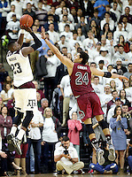 Texas A&M's Danuel House (23) attempts a three point shot againt South Carolina's Michael Carrera (24) during the second half of an NCAA college basketball game, Saturday, Feb. 6, 2016, in College Station, Texas. South Carolina won 81-78. (AP Photo/Sam Craft)